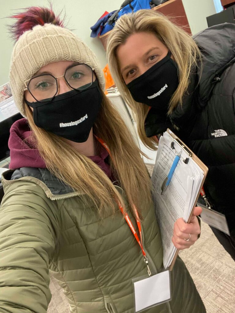 Two housing stability workers wearing their #housingoxford COVID-19 masks.